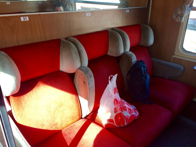 Row of three seats inside a second class compartment on the train from Podgorica to Belgrade.